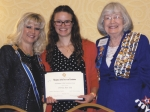 Indiana Daughters of the American Revolution State Regent Jeanie Hornung (left) and LaVonne Waldron, state chairman, Indiana DAR Scholarship Committee (right) award a $1,000 scholarship to Olivia Ray Ely at the Indiana DAR State Conference.