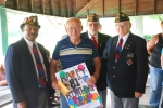 Representatives of Veterans of Foreign Wars Post 2689 present an 81st birthday card to Gene Sheets (second from left), recipient of funds raised by Dad's Ride on June 20.
