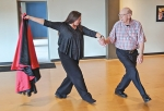 "Professional ballroom dancer Kelly Bartlett (left) and Korean War veteran Larry Smith, of Huntington, go through the steps in preparation for the ""Dancing with the Heroes"" fund-raiser Aug. 17, at Ceruti's Banquet & Event Center in Fort Wayne."