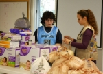 Bethany Marcum (left), a member of Girl Scout Troop 20042, helps Bethany Brunner, a member of Troop 20279, package diapers Brunner collected for the Youth Services Bureau's On Your Way Up store.