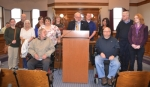 Representatives of the Huntington County Council on Aging, Pathfinder Services, City of Huntington and the Mayor's Advisory Council on Accessibility gathered on Tuesday, Feb. 21, to witness Mayor Brooks Fetters' declaration of March as Disability Awareness Month in the city of Huntington. They are (front, from left) Brian Kirkpatrick and Gary Johnson; (middle row, from left) Tisha Grimme, Trena Gamble, Vickie Kirkpatrick, Mayor Brooks Fetters, Loretta Mottram, Dick Murray and Amanda Gutshall; and (back, from left) John Niederman, Rachel Harmsen, Ronda Smelser and Adam Cuttriss.