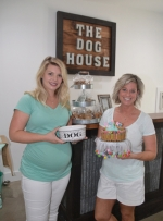 Alexis Niedzwiecki (left) and her mom, Lori Niedzwiecki, have opened The Dog House Grooming Salon and Spa in Roanoke. Alexis handles grooming responsibilities, while Lori takes care of the business and as well as baking some of the doggie treats sold in the shop's boutique.