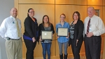 Celebrating at the presentation of the Jill Dreyer scholarships for spring 2017 are Parkview Huntington Hospital team members (left to right) Doug Selig, vice president, Patient Care Services; Katie Mitchell, manager, Emergency Department; Edna Salazar, Emergency Department nurse and scholarship winner; Olivia Eckert, Medical/Surgical patient care technician and scholarship winner; Jenny Dohrman, manager, Inpatient Services; and Mike Perkins, director, Parkview Huntington Foundation.