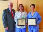 Parkview Huntington Hospital nurses Amy Watson (center) and Conni Harris-Shoemaker (right) celebrate their selection for Jill Dreyer scholarships with Mike Perkins, director of Parkview Huntington Foundation, which administers the scholarship funds.
