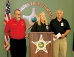 Lindsie Goss (middle), director of the Huntington County Emergency Management Agency, asks citizens to report flood damage to the Indiana Department of Homeland Security to help the state's chances of receiving financial assistance from the federal government with the clean-up process during a press conference on Thursday, July 23, at the Huntington County Jail. Goss is flanked by Keith Walters (left), director of the Wabash County EMA, and Ralph Frazee, director of the Jay County EMA.