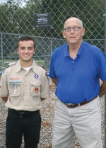 Eagle Scout Jack Young (left) is pictured with Clear Creek Township Trustee Jay Hammel. Young restored the Clear Creek ball diamond playground as his community service project to obtain the highest rank in Boy Scouts.