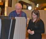 Election worker Ray Scribner (left) instructs voter Talia Finney in the use of a voting machine on Wednesday, April 8, at an early voting site in the Huntington County Courthouse. Finney was one of a handful of voters to cast ballots during the first week of early voting. Satellite vote centers will open beginning April 28, and four sites will be open to voters on Election Day, May 5.