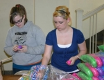 Jessie May (left) and Jenni Gaither, members of Job's Daughters, stuff plastic Easter eggs for the Huntington Jaycees' 2010 Easter egg hunt. The event will be held 9 a.m. on Saturday, March 27, at Memorial Park.