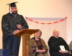 Graduate Jason Patton (left) addresses his peers during a high school equivalency graduation ceremony on Friday, Feb. 27. Patton said he failed to graduate the first time around after spending his high school years as the class clown. He decided to get his diploma after being turned down for a job and now says he plans to go on to college. Looking on are (from left) Jean Hayden and Rev. Kathy Newton.