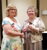 Outgoing Indiana Extension President Cathy Cook (left) hands the gavel to the new president, Stephanie Jerabek, of Huntington, during the recent Indiana Extension Homemakers Association conference.