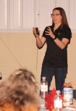 Melissa Widhalm, operations manager for the Purdue Climate Change Research Center, speaks at the Purdue Extension Huntington County annual meeting on Monday, Nov. 18, in First Merchants Bank Heritage Hall on the Huntington County Fairgrounds. Widhalm presented information on how climate change is impacting Indiana.
