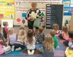 Rita McCabe of the Huntington County Extension Homemakers shares a book recently with a class at Head Start as part of her service with the Extension Homemakers. Club members also made book bags to give to the children.