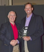 First Federal Savings Bank President and CEO Michael Zahn (right) accepts the Five Star Award on behalf of the bank from Indiana Bankers Association President and CEO Joe DeHaven on Tuesday, May 12, at the association's Mega Conference, held in Indianapolis.