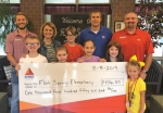 """Students of Flint Springs Elementary School and representatives of Johnson Petroleum celebrate the donation of $1,456.50, the proceeds from the company's """"spirit pump"""" program. Pictured are (front row from left) Aviaz Land, Audrey Hosier, Zech Shultz, Claire Herendeen, Hannah Wajer and Blakeley Johnson; and (back row from left) Tayler Johnson, Johnson Petroleum representative; Aimee Lunsford, Flint Springs principal; Tanner Johnson and Blake Lyon, Johnson Petroleum representatives."""