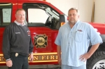 Huntington Fire Department Chief Matt Armstrong (left) is pictured with Kenny Dunn, store manager and special events coordinator of Homier Distributing. Homier is celebrating its 10th anniversary by raising funds for the fire department.
