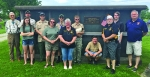 Markle Scout Troop 128, adult leaders and family members helped Veterans of Foreign War members, as in previous years, place flags on veterans' graves at Markle Cemetery on May 25. Pictured are (front row from left) Kayla Caston, April Caston, Brenda Jenks of Huntington VFW 2689 Auxiliary and Larry Jenks and Rick Waikel Huntington of VFW Post 2689; also (back row from left) David A. Pence, Scout Master Kent Caston, Assistant Scout Master David W. Pence, Matt Pence, Chase Caston, Christian Bowman and Sam Cook.