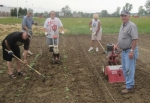 Local volunteers (from left) Ron Hammel, Bob Koehlinger, Dean Rittenhouse, Phyllis Stouder and Lowell Stouder work in the Helping Hands garden adjacent to Huntington North High School.