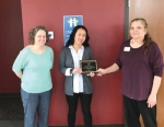 Katie Garrett (middle) accepts the Child Protection Team Ronald Mitchell Award recently from Child Protection Team Chairman Jan Williams (right) while Department of Child Services Director Kerri Baker looks on.