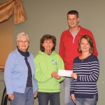 Jennifer Hotchkiss (right) and Jamie Hotchkiss (back right), of Union Church, present a check for $11,000 to Kathie Mower (middle), director of By the Book, and Nancy Beaver, president of the Associated Churches of Huntington County, on Tuesday, Nov. 19, at The Gathering Place, in Huntington. The donated funds were raised at a fish fry the Hotchkisses coordinated at their church on Nov. 7. By the Book is a weekly religious education program sponsored by the Associated Churches of Huntington County.