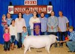 Huntington County 4-H member Kennidy Lauer won the champion chester white gilt at the 2015 Indiana State Fair and went on to win fourth place overall for gilts. Showing off the animal are (front row, from left) Bristol Buckland, Gracie Lauer and Kendall Lauer; and (back row from left) Matt Buckland holding Briar Buckland; Kennidy's parents, Tina Lauer and Chad Lauer; Kennidy Lauer; Jesse Hinman; Brad Mortensen, judge; and Kent Brattain.