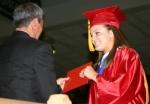 Huntington North senior Amanda Dyson, right, accepts her diploma from Huntington County Community School Corporation Board of School Trustees Vice President Rick Brubaker on Friday, June 4.