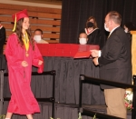 Jessica Smith (left), valedictorian of Huntington North High School's Class of 2020, walks to accept her diploma from Matt Roth, president of the Huntington County Community School Corporation Board of School Trustees, on the first day of Huntington North's commencement ceremony, Friday, May 29. Commencement continued on Saturday, May 30, and was split into two sessions to reduce the number of attendees because of COVID-19 guidelines.