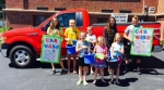 Students of Huntington Catholic School gather in preparation for their car wash fund-raiser on Saturday, June 17. Pictured are (front row, from left) Genevieve Harrell, Addisen Bischoff and Karsen Bischoff; and (back row, from left) Lillian Holzinger, Lindsay Godfroy, Noah Kenny, Olivia Godfroy and Adam Holzinger.