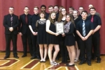 HNHS senior Jazz Band members Kaitlyn Burkhart (left) and Katie Hunt hold the gold award the group received at a state jazz competition, while other members of the band gather behind. The HNHS band will join with the Erie Community Jazz Band in a jazz concert tonight, Monday, May 15, at the Huntington County Courthouse.