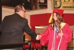 Julia Crist (right), a senior at Huntington North High School, shakes hands with Matt Roth, president of the Board of School Trustees, before accepting her diploma during the school's Class of 2019 graduation ceremony on Sunday, June 2, in North Arena.