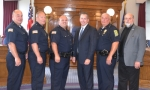 Three members of the Huntington Police Department — Sgt. Andy Ellet, Det. Capt. Cory Boxell and Capt. Shane Jones — received promotions during a ceremony on June 22. Celebrating the occasion are (from left) Chief Chad Hacker, Assistant Chief Matt Hughes, Ellet, Boxell, Jones and Mayor Brooks Fetters.