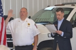 Huntington Township Vounteer Fire Department Chief Paul VonBank (left), along with the rest of his department, is sworn in by Sen. Jim Banks during a dedication ceremony for the department on Saturday, April 16.