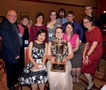 Huntington University student Esther Higginbottom holds the President's Cup won by  the university's Beta Chapter of the Alpha Chi National College Honor Society after being selected as Outstanding Chapter of the Year. The award was presented at the society's annual convention held March 19 through 21 in Chicago. Also attending from HU were (front row, from left) Alpha Chi sponsor Dr. Paul Michelson, students Yang Wu and Higginbottom; (middle row, from left) Alpha Chi sponsors Jean Michelson and Dr. Ruth Nalliah and students Jannea Thomason, Bronwen Fetters and Emily Thornton; and (back row, from left) students Alex Hoffman, Andrew Wickersham and Luke Batdorff.