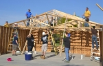 A team of volunteers from General Motors' Fort Wayne Assembly Plant installs the trusses on a Habitat for Humanity house, in Huntington, on Thursday, May 22.