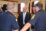 Huntington Police Chief Chad Hacker (center) talks with officers after his appointment was announced on Wednesday Oct. 1.