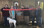 Robert Knorr (fifth from left), the executive director of Harmony Home, in Huntington, leads a ribbon-cutting ceremony at the residence, which is a place for adult male drug and alcohol addicts to acquire sobriety. Pictured are (from left) Michael Lester and Robin Lester, Harmony Home Board of Directors; Brian Gamlin, supporter; JoAnn Young, board of directors; Knorr; LuAnn Graf, board of directors; and Stephanie Smith and Jim Smith, supporters.