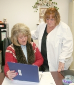 Public Health Nurse Debra Doctor (seated) goes over some information on the H1N1 virus with Suzi Morgan, RN. The health department is now offering a mobile setup for businesses and organizations to administer the vaccine to employees.