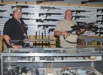 Hillside Shooting Sports General Manager Mike Swaidner (left) and archery department owner Tom Griffith display some of the new inventory the store now carries since it opened a 6,000- square-foot showroom and indoor archery range recently.