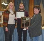 Teresa Beck (left) and Lisa Street (right) accept the David A. Schenkel Memorial Award for Historic Preservation on behalf of the Markle Historical Society on Tuesday, Jan. 30, from Huntington Alert President Brant Ricker.