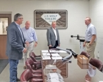 Huntington County Commissioners (from left) Tom Wall, Larry Buzzard and Rob Miller chat with Keith Miller (right), president of J.O. Wolf Tool & Die on Tuesday, Sept. 25, during a tour of the facility. The company recently completed the purchase of new equipment, representing an investment of more than $200,000.