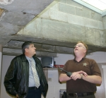 "Huntington County Commissioner President Tom Wall (left) inspects the roof of ""D block"" at the Huntington County Jail, as Jail Commander Steve McIntyre explains repairs the jail will need in the near future on the commissioners' tour of the facility."