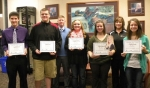 Huntington North High School Artists of the Month are (front row, from left to right) Jacob Vinson, Caleb Cross, Katelynn Farley, teacher Kortney Brubaker holding student Kylie Frederick's picture and Jessica Fowler. Teachers (back row, from left to right) are Nick Altman and Michele Santa.