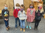 Horace Mann Elementary School students (from left) Tytus Ladyga, Caleb Kendall, Major Southerland, Olive Gearhart and Paisley Kilkenny, display a portion of money raised during the school's Jar Wars.