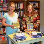 Laura Summer (left) and Alicia Bowers display some of the jigsaw puzzles that have been added to the offerings at the Community Book Swap, which is open twice a month at the Huntington Church of the Brethren, 306 E. Washington St., Huntington.
