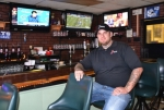 Owner Cliff Coon sits inside the new location of Jimmy Pop's Pizza Shop at 863 E. Market St., in Huntington.