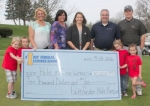 Children from Kids Kampus display a check for $10,000 that could be awarded during the Kids Kampus Golf Outing on May 18 at Norwood Golf Club. The prize, sponsored by First Federal Savings Bank, will be split between anyone who hits a hole in one on the 11th hole and Pathfinder Kids Kampus. Pictured (from left) are Asher Draffen, Gavin Pape, Kids Kampus Director Jodie Clark, Pathfinder Services Senior Director of Business Development Loretta Mottram, Satin Lemon of First Federal Savings Bank, Bill Miller of David Culp and Co., Norwood Golf Club Pro Patrick Davis, Haley Taylor and Rebecca Hire.
