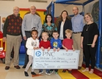 Sponsors of the annual Pathfinder Kids Kampus Turkey Trot present a check for $29,950 to representatives from Kids Kampus on Monday, Feb. 19. The funds will go toward scholarships that will enable children to attend Kids Kampus. Pictured are (front row from left) Kids Kampus preschoolers Emmery Maher, Camden Zahn, Wesley Pape and Ethan Lehman; and (back row from left) John Niederman, president, Pathfinder Services; Britt Sather, representing host sponsor McDonald's of Huntington; Becky Scheiber, representing lead sponsor PNC Bank; Janelle Pflieger and Matt Pflieger, representing lead sponsor Cardinal Family Medicine; and Elizabeth Hire, interim administrator and Early Head Start director, Kids Kampus.