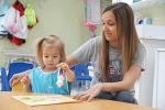 Preschooler Clara Reckelhoff (left) gets some assistance from Pathfinder Kids Kampus teacher Jen Horn. Pathfinder Kids has openings for the On My Way Pre-K program that provides free preschool and childcare to 4-year-old children.