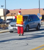 Knights of Columbus member Bruce Van Gilder, dressed as Santa Claus, collects money during the 2019 Pitch-In at the intersection of North Jefferson and MacGahan streets.