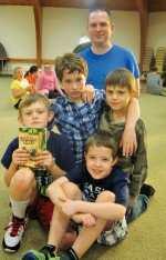 The Huntington Kids Club is inviting more kids to join. Pictured (front row, from left to right) are members Aden Kalhoefer and Blaine Bower; (middle row, from left to right) Chad McGroder and Korbin Kalhoefer; and (back row) Brett Evans.