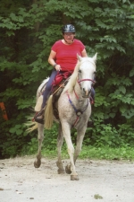 "Janet Kirkpatrick, of Andrews, and her Arabian horse, HA HI Fire, or ""Booker,"" make their way together on a competitive trail ride in Ohio. The team recently marked a total of 100 years in age."
